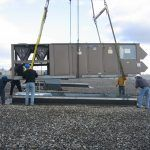 Installing one of 5 40-ton rooftop units on LV Plastics Lab